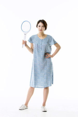 culicidae: Asian Girl in Pajamas Trying to Catch Mosquittoes Stock Photo