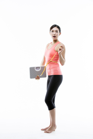 Beautiful Asian Woman Working out Diet Concept