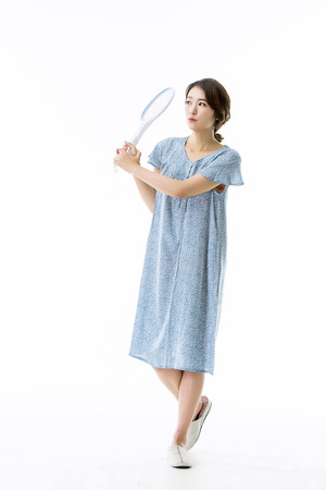 hexapoda: Asian Girl in Pajamas Trying to Catch Mosquittoes Stock Photo