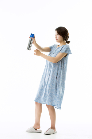 eradication: Asian Girl in Pajamas Trying to Catch Mosquittoes Stock Photo