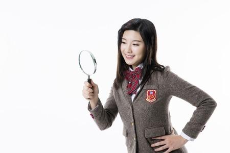 carefully: Asian Highschool Students Stock Photo