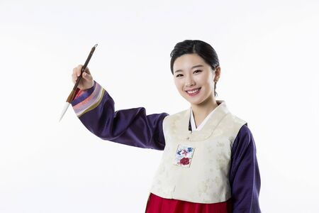 hanbok: Portrait of Young Asian Couple in Korean Traditional Clothes, Hanbok Stock Photo