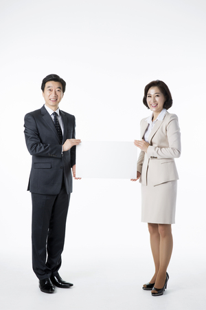 Portrait of Middleaged Asian Couple - Career in Midlife Stock Photo