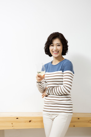 korean style house: Middleaged Asian Woman in Livingroom