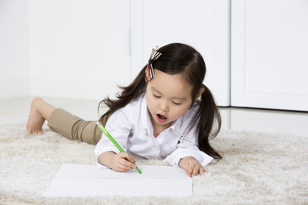 Cute Asian Girl Drawing,Laying on Floor