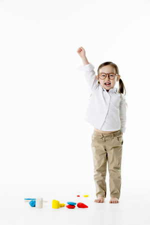 Little Asian Girl with Glasses,Rasing One Hand - Isolated on White