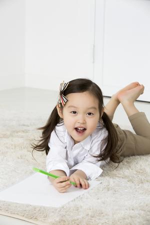 asian family fun: Cute Asian Girl Drawing,Laying on Floor