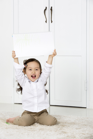asian family fun: Cute Asian Girl Holding up,Showing Her Sketchbook