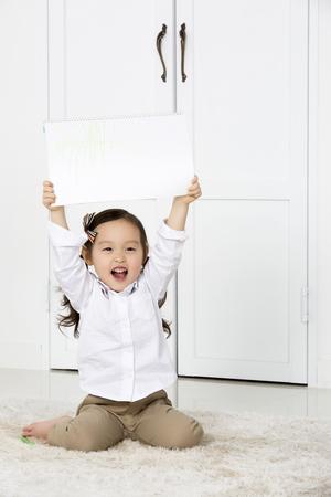 sketchbook: Cute Asian Girl Holding up,Showing Her Sketchbook