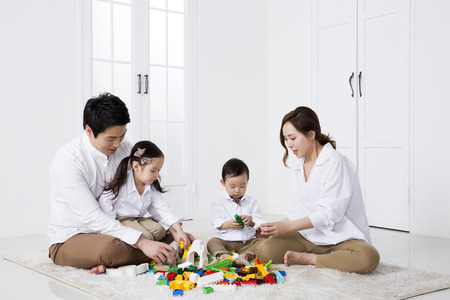 Happy Asian Family Playing with Building Blocks at Home 스톡 콘텐츠