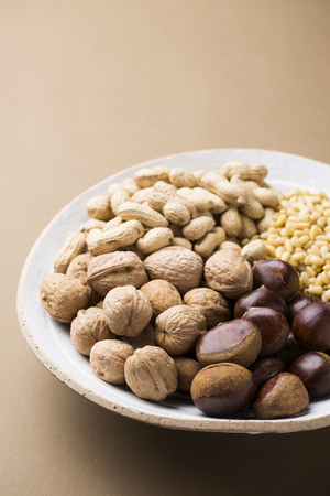 unsaturated: Different Types of Nuts on a White Plate