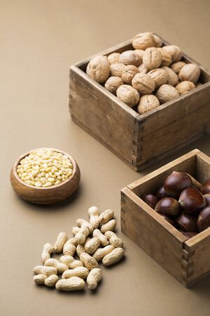 unsaturated: Various Nuts, Peanuts, Chestnuts, Walnuts, Pinenuts, Bulk Food, Unprocessed, Plain Background, Rustic Boxes
