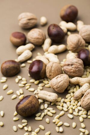 unsaturated: Various Types of Nuts Scattered Stock Photo