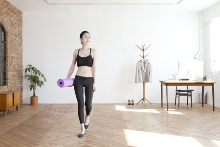 sports clothing: Performing yoga alone