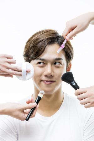 puff: Young Asian Man with Makeup Tools