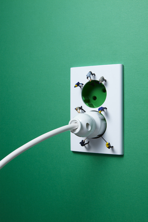 electrical plug: Electrical plug and the green wall