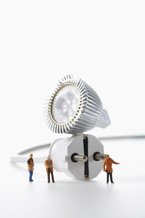 electrical plug: Light bulb and electrical plug isolated