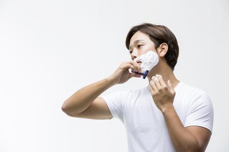 Young Asian Man Shaving
