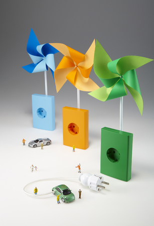 Green, orange and blue wind vanes isolated