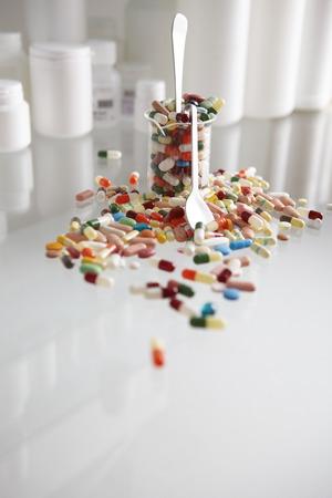 too many: Too many pills in a beaker