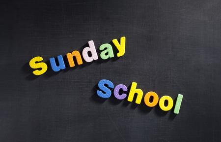 Magnetic letters on blackboard spelling out Sunday School