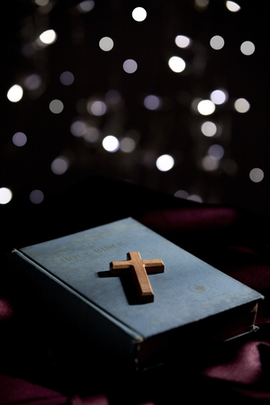 new testament: Closed holy bible with a wooden cross on the cover Stock Photo