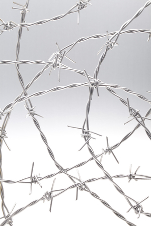 barbed wire isolated: Circular barbed wire isolated Stock Photo