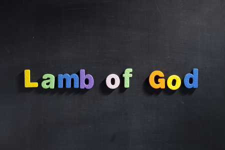 lamb of god: Magnetic letters on blackboard spelling out Lamb of God