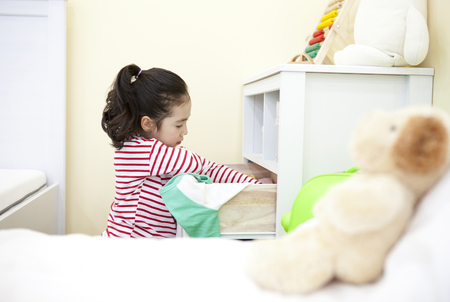 A child organizing the drawer