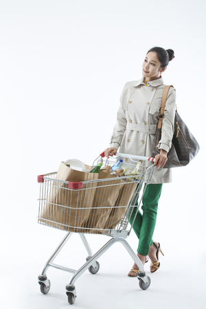 A woman casually dressed grocery shopping