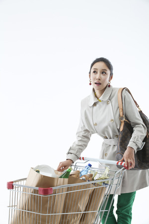 casually dressed: A woman casually dressed grocery shopping