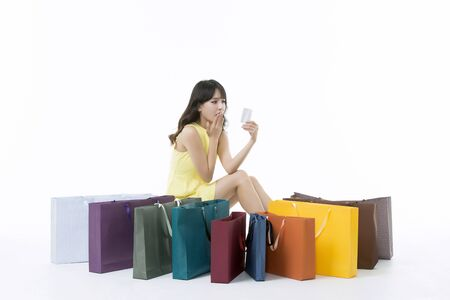 A young woman carrying a bunch of shopping bags Stock Photo