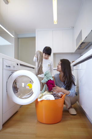 Mother And Daughters Laundry Time Stock Photo
