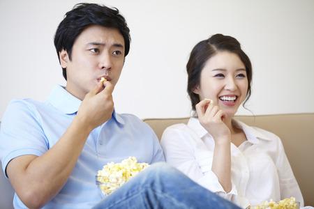 pareja viendo tv: Couple Watching TV Together