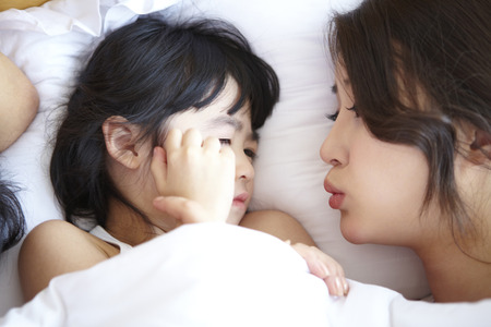 Asian Family Comfortable At Home Stock Photo