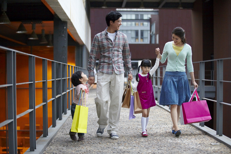 Family Going Home After Shopping