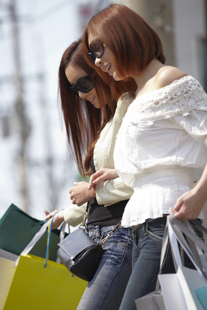 A Young woman,young Out Shopping With A Friend Stock Photo