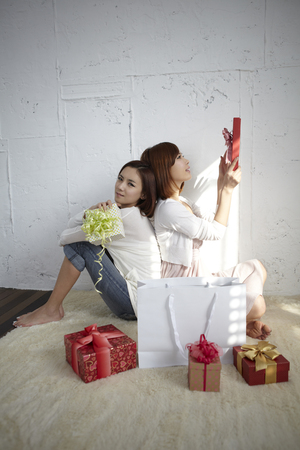 fiend: Two Young Women Checking Out Gifts Stock Photo
