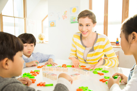 Young Students Learning English With A Foreign Female Teacher Stock Photo