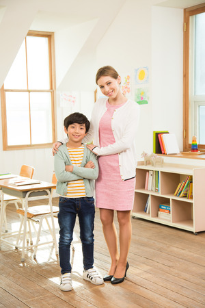 educator: A Student Standing Next To Female English Teacher