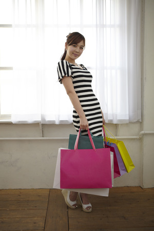 fiend: A Young woman,young Posing With Shopping Bags