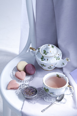 A Cup Of Lavender Tea With Macaron
