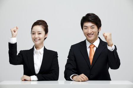 fist pump: Male And Female Coworkers In Studio Setting Stock Photo