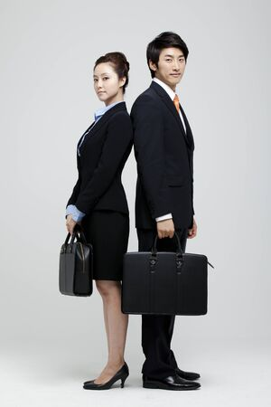 Male And Female Coworkers In Studio Setting Stock Photo