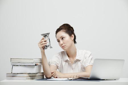 malcontent: Studio Shot Of A Malcontent Female Company Employee Stock Photo
