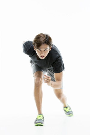 Young Athletic Male In Starting Position Stock Photo
