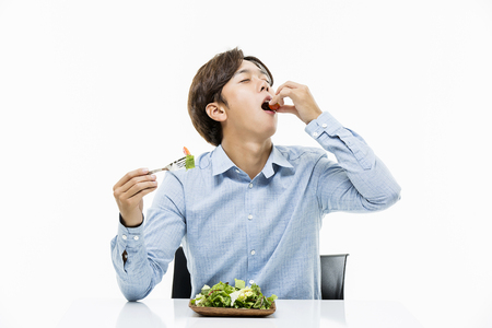 Young Male Eating Salad Stock Photo