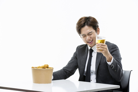 beer and necktie: Young Businessman Having Chicken And Beer