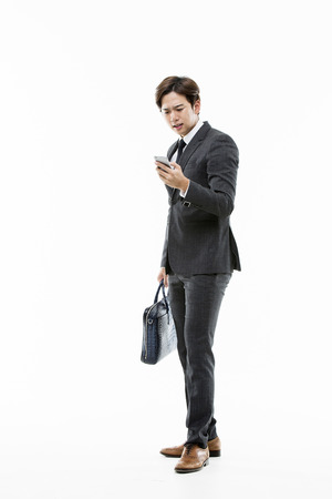 Young Businessman Carrying A Briefcase Stock Photo