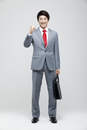 Young Businessman In Full Suit Standing